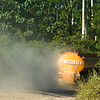 An oil tanker rumbling down the dry and dusty Via Pindo oil road in the Ecuadorian Amazon